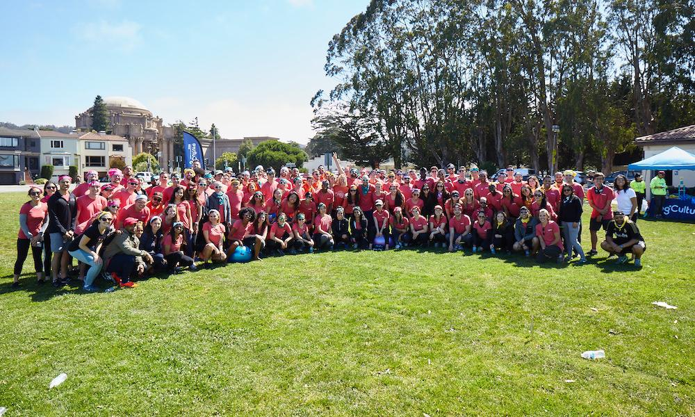 Large group photo of Handshake team members wearing red T-shirts