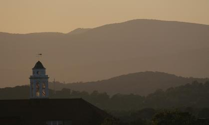Wilson Hall silhouetted against the mountains