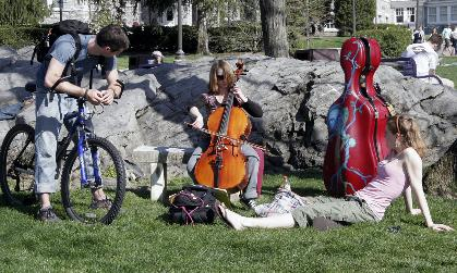 "Female student practicing cello at the ""Kissing Rock"""