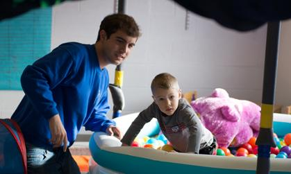 A JMU student supervises a child in a JMU Occupational Therapy Clinical Education Services program.