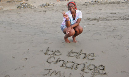 Image of JMU student on the beach during her study abroad program.