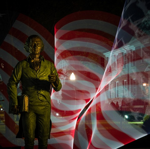photo of Jimmy statue with American flag