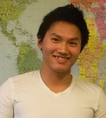 Profile of Anh Quy Nguyen as he stands in front of a map