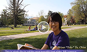A JMU student reads a book on the Quad