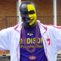 Prince Owusu wearing his purple and gold