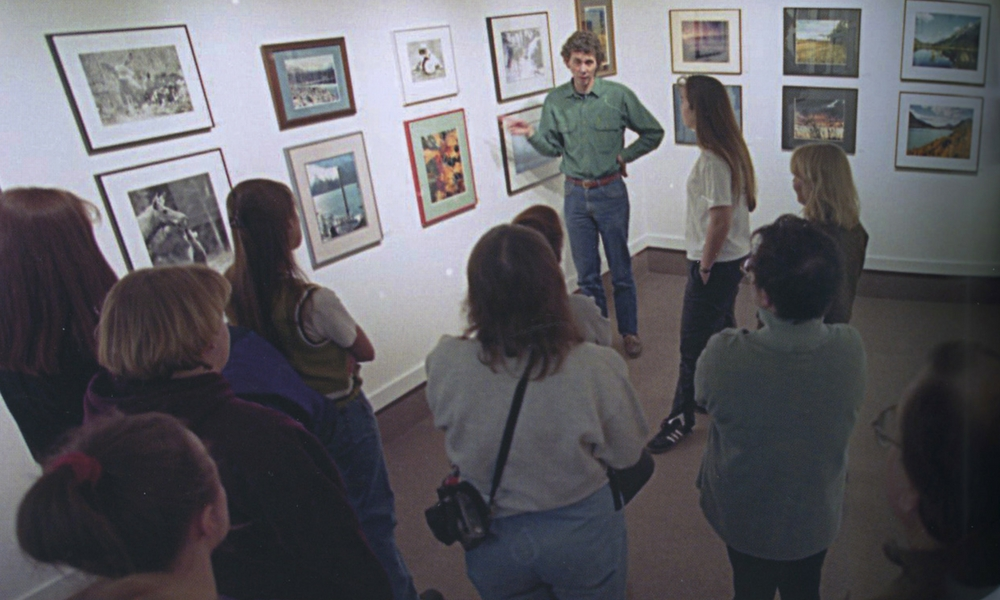 Gary Freeburg with students in the gallery