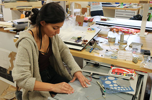 Students work in a JMU art studio.