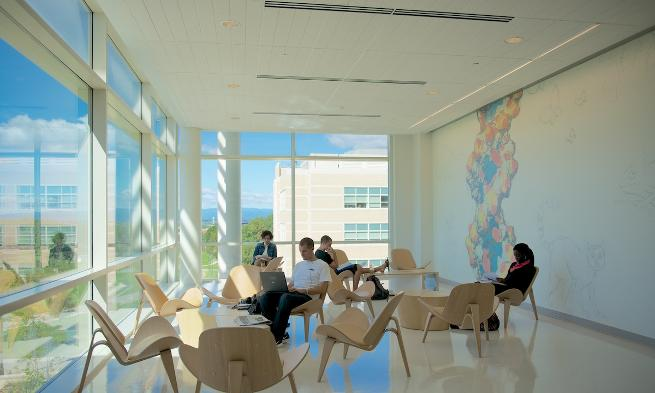 A student studies in the Bioscience building overlooking the mountains.