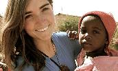 Christine Bolander holding Ugandan child