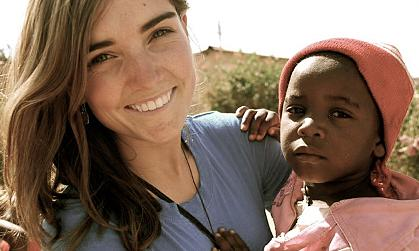 Christine Bolander with Ugandan child
