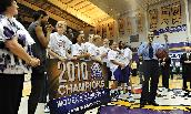 The JMU Women's Basketball team celebrates a CAA Championship.
