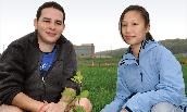 ISAT majors Nicolas Jaramillo ('09) and Bonnie Tang ('09) check a tree sapling.