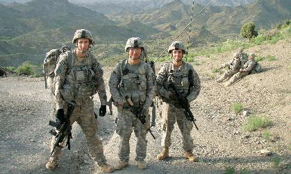 Army 1st Lt. Tyler Moyer stands between two fellow Army officers in Afghanistan.