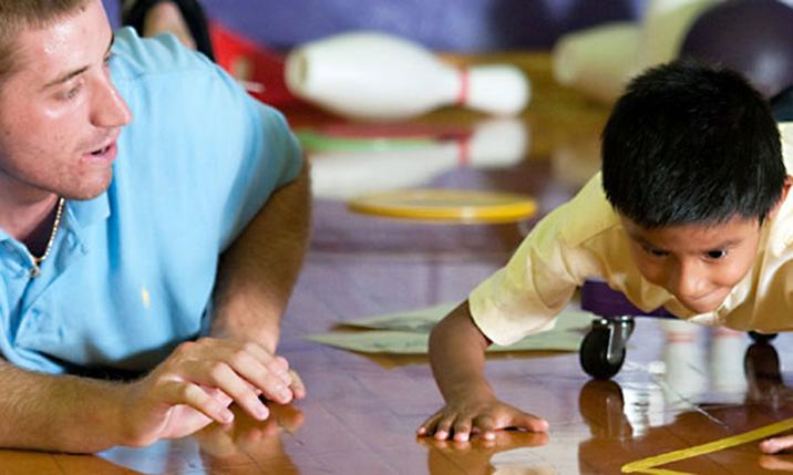 A JMU student works with child as part of the Overcoming Barriers program