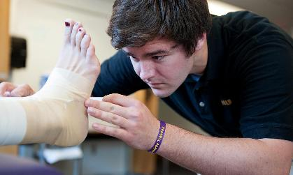 Andy Russo ('15), a JMU athletic training major