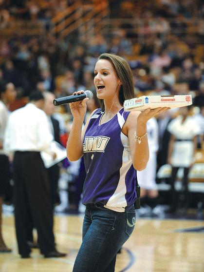 Elle Bunn gets Duke fans excited at halftime as she offers a pizza to the loudest fan.