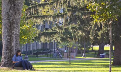 Student Reading on Quad