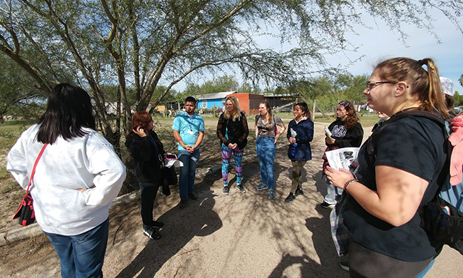 Group of students and faculty at US-Mexico border
