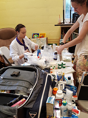 PHOTO: students packing supplies
