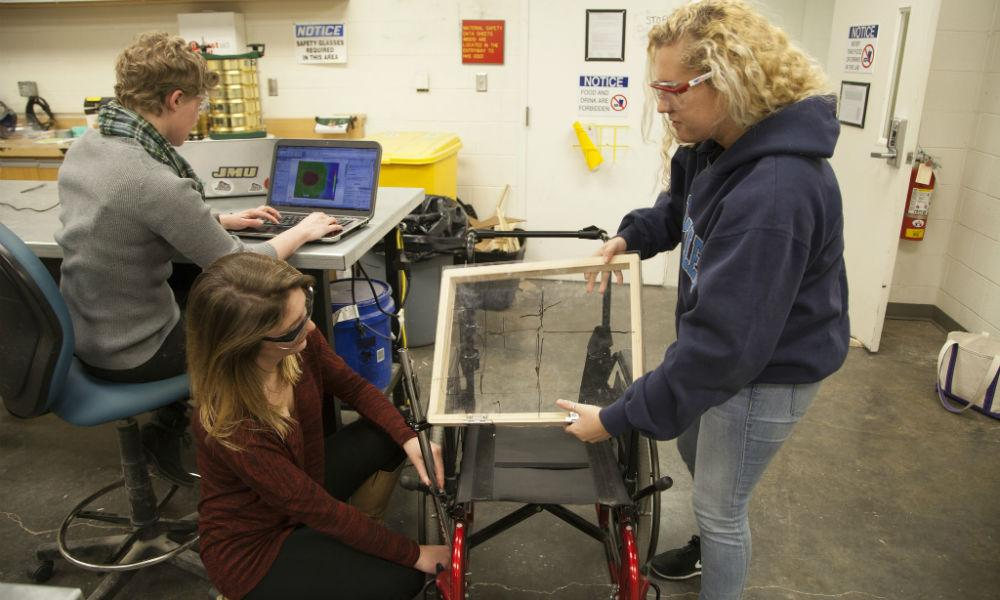 image: /_images/cise/story-photos/week-of-making/engineering-students-working-on-wheelchair.jpg
