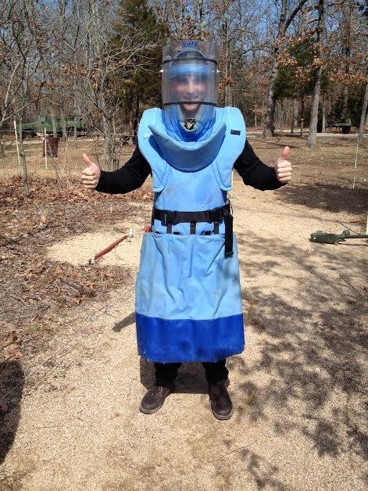 Chris Murguia in personal protective/demining gear