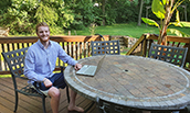 CIS major Wes Jamison in his deck 'office' while participating in a virtual internship - 2020