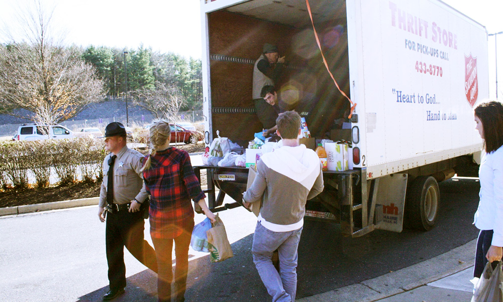 Students loading the truck with donations for the 2013 Brent Berry Food Drive