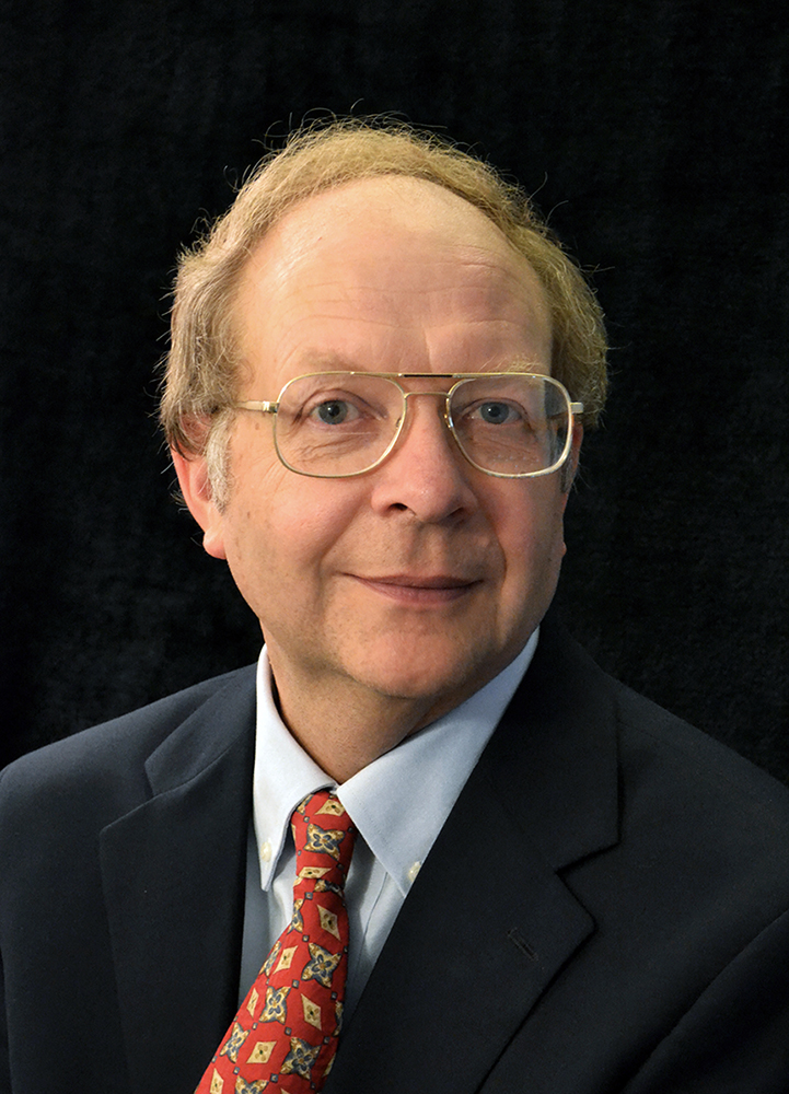 Dr. William C. Wood, Economics