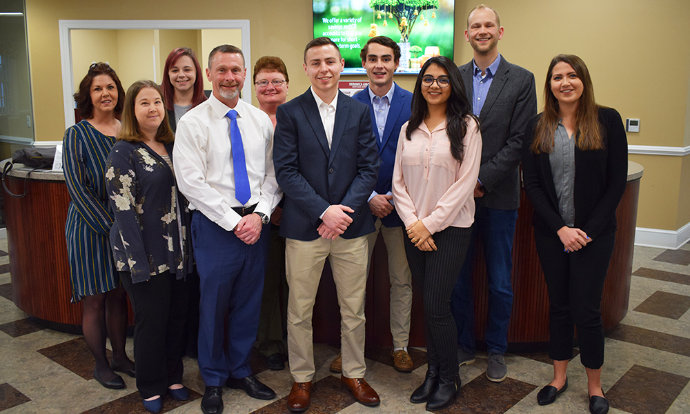 JMU Banking Team members and advisor Carl Larsson (2nd from right) with members of F&M Bank
