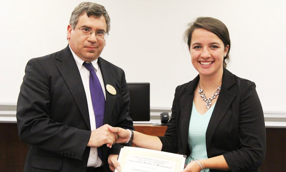 Korinne Sulewski receiving 2015 Outstanding Student in Management award
