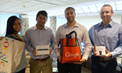 Four student winners of the Silverback Strategies AdWords challenge with their prizes
