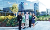 Dr. Theresa Clarke and four JMU students in front of Google headquarters in 2015