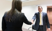 Student shaking hands with a judge during Internal Sales Competition - 2017