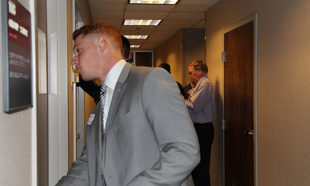 JMU Marketing Student entering room during Internal Sales Competition