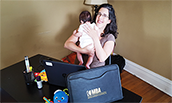 MBA Student Heather Joffe-Reyes, studying at home with son