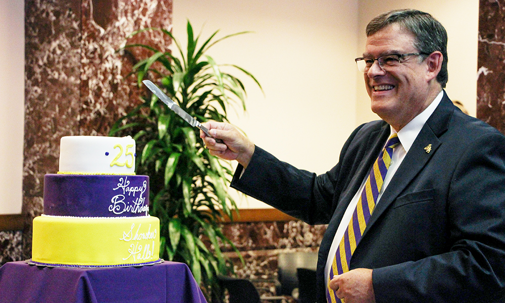Joe Showker cutting the cake at the Zane Showker Hall 25th birthday - 2016