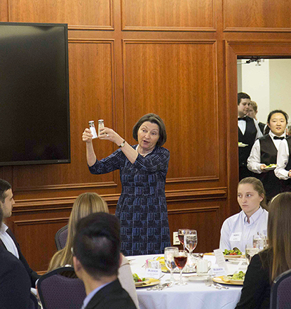 Students getting a demonstration at the 2017 Etiquette Dinner