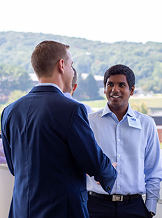 Two MBA students get to know one another at orientation