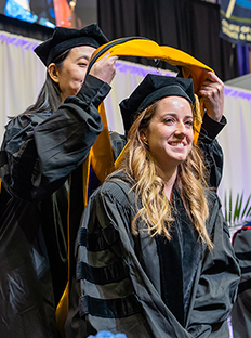 JMU Student getting her stole at graduate commencement