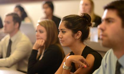 Students listen intently during a class in Showker Hall