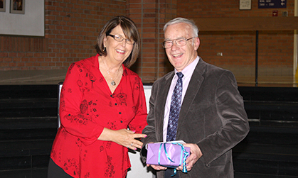 Huffman receiving gift of service