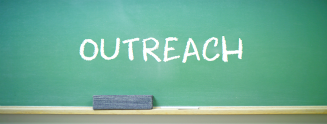 The word outreach written on a chalkboard