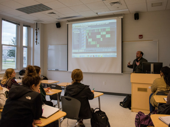 Image of Sean Tubbs presenting on audio editing program Adobe Audition to Sarah O'Connor's WRTC students