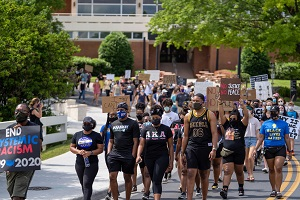 students and community members marching across campus