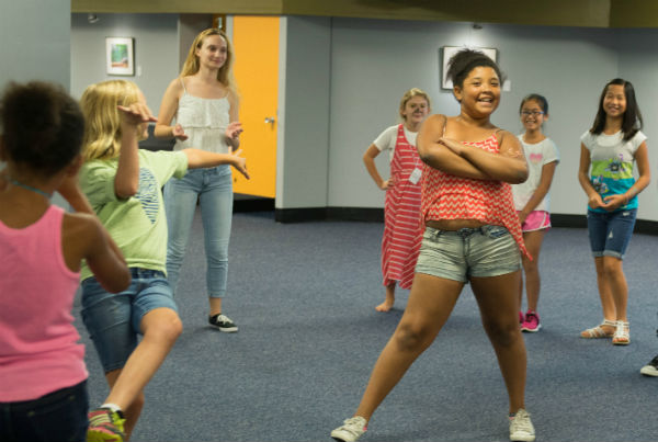 Children and counselors express themselves with movement at 2014 Poetry Camp.