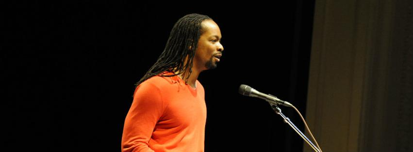 Photo of Jericho Brown reading poetry