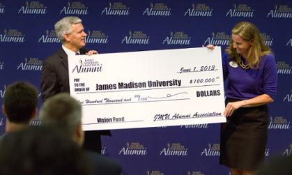 JMU alumni association president Jamie Jones Miller presents check to President Alger for Madison Forever Vision Fund