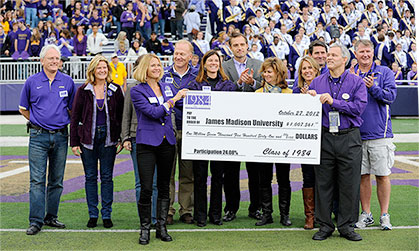 Class of 1984 present a $1 million check on the field of the Bridgeforth Stadium