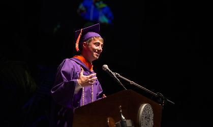 JMU student Matt Wisniewski addresses the crowd at senior convocation