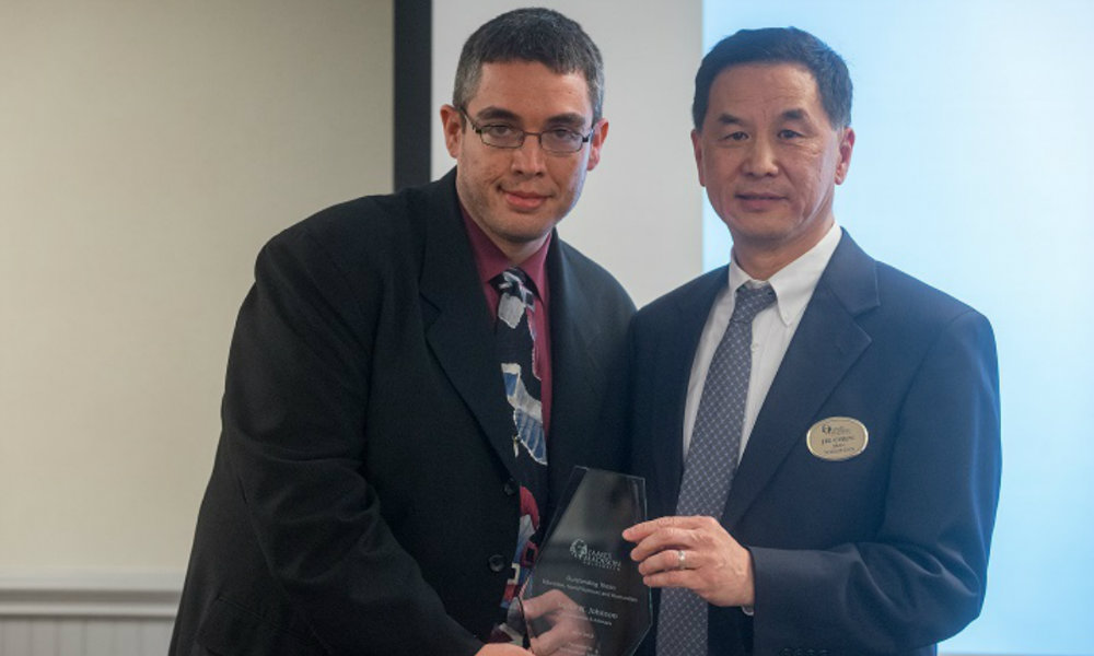 Picture of student with Dr. Chen